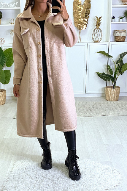 Veste très chaude en rose avec poches au buste et boutons