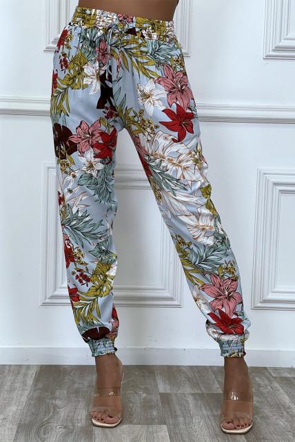 Pantalon fluide turquoise en coton avec motif fleuris